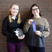 Emily Dironca and Taylor Willamson hold an award they received for College Algebra